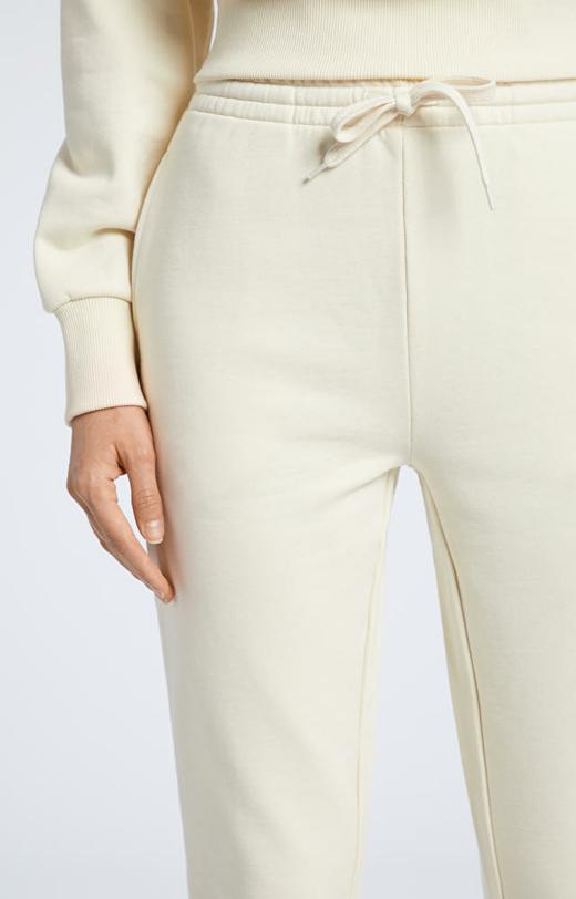 Kremowe spodnie dresowe WÓLCZANKA